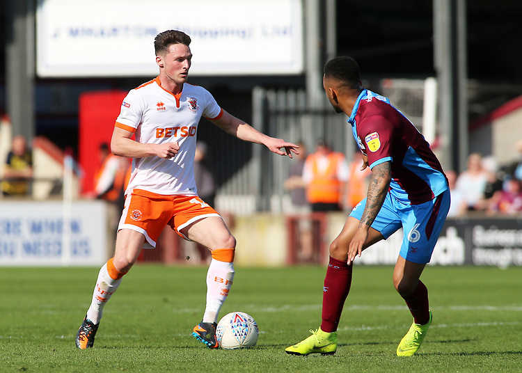 Blackpool's Jordan Thompson takes on Scunthorpe United's Funso Ojo<br /> <br /> Photographer David Shipman/CameraSport<br /> <br /> The EFL Sky Bet League One - Scunthorpe United v Blackpool - Friday 19th April 2019 - Glanford Park - Scunthorpe<br /> <br /> World Copyright © 2019 CameraSport. All rights reserved. 43 Linden Ave. Countesthorpe. Leicester. England. LE8 5PG - Tel: +44 (0) 116 277 4147 - admin@camerasport.com - www.camerasport.com