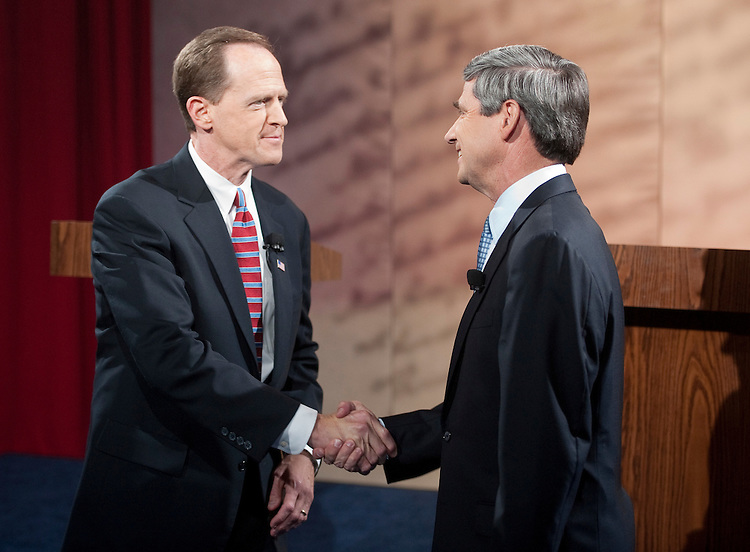 UNITED STATES - OCTOBER 20: Republican Senate candidate Pat Toomey, left, shakes hands with Democratic candidate Joe Sestak before the start of their at the National Constitution Center in Philadelphia on Wednesday, Oct. 20, 2010. (Photo By Bill Clark/Roll Call via Getty Images)