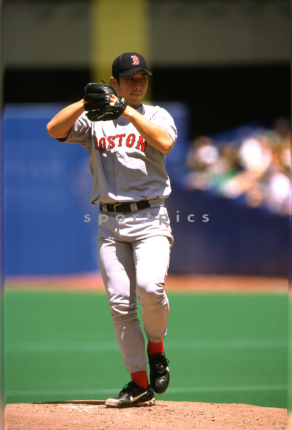 Boston Red Sox Hideo Nomo (11) in action during a game from his 2001 season with the Boston Red Sox. Hideo Nomo  played for 12 years with 7 different teams,  was a 1-time All-Star and was the 1995 National League Rookie of the Year.