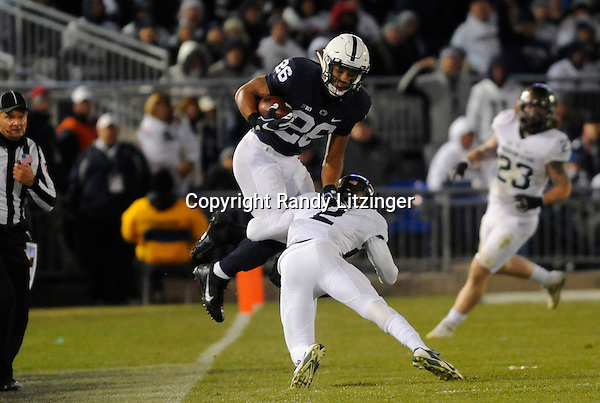 STATE COLLEGE, PA - NOVEMBER 26:  Penn State RB Saquon Barkley (26) jumps over hurdles Michigan State CB Darian Hicks (2). The Penn State Nittany Lions defeated the Michigan State Spartans 45-12 to win the Big Ten East Division on November 26, 2016 at Beaver Stadium in State College, PA. (Photo by Randy Litzinger/Icon Sportswire)