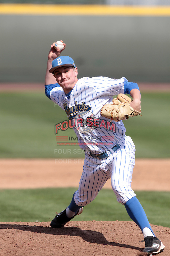 David Berg #26 of the UCLA Bruins pitches against the Maryland Terrapins at Jackie Robinson Stadium on February 19, 2012 in Los Angeles,California. Maryland defeated UCLA 5-1.(Larry Goren/Four Seam Images)