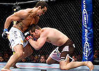 "Vitor Belfort (cq, 6'0''/195lbs), of Rio De Janeiro, Brazil makes his knockout hit against Rich Franklin (cq, 6'1""/195lbs), of Cincinnati, OH, to win the main event of the Ultimate Fighting Championship 103 at the American Airlines Center in Dallas, Texas, Saturday, September 19, 2009. There was a sold out crowd to watch the 15 fights which also aired on Pay Per View...PHOTOS/ MATT NAGER"