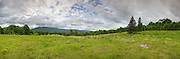Panoramic of Breezy Point in Warren, New Hampshire USA during the summer months. These fields were once the site of 19th century resort hotels known as Merrill's Mountain Home, the Breezy Point House and the Moosilauke Inn. This image consists of nine images stitched together