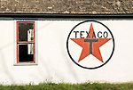 Texaco star painted on the side of an old gas station on the Great Plains, Haswell, Colorado.
