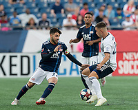 FOXBOROUGH, MA - JUNE 26: Carles Gil #22 dribbles as Kai Wagner #27 defends during a game between Philadelphia Union and New England Revolution at Gillette Stadium on June 26, 2019 in Foxborough, Massachusetts.