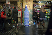 "A promotional device for Skyy Vodka in Chelsea Market in New York on Saturday, December 5, 2015 uses the craft of 'knit bombing"" to wrap promotional items with yarn. Knit bombing, graffiti knitting, yarn bombing, etc., uses knitted or crocheted yarn as opposed to chalk or paint. (© Richard B. Levine)"