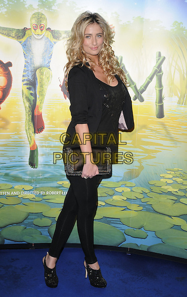 "CHANTELLE HOUGHTON .At the Cirque du Soleil ""Totem"" press Tour, Royal Albert Hall, Kensignton Gore, London, 5th January 2011..Full length black jacket top shoes leggings clutch bag platform slingbacks shooboots .CAP/CAN.©Can Nguyen/Capital Pictures."