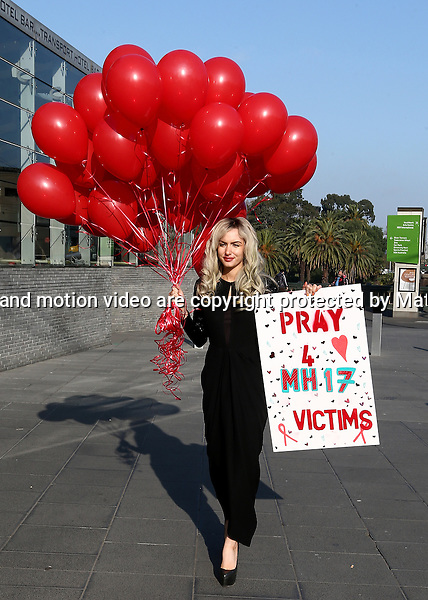 22 JULY 2014 SYDNEY AUSTRALIA<br /> <br /> NON EXCLUSIVE PICTURES<br /> <br /> Gabi Greko pictured in Federation Square Melbourne with some red balloons - Gabi released the balloons in a touching tribute to the victims of Flight MH17.<br /> <br />  *No internet without clearance*.<br /> MUST CALL PRIOR TO USE <br /> +61 2 9211-1088. <br /> <br /> Matrix Media Group.Note: All editorial images subject to the following: For editorial use only. Additional clearance required for commercial, wireless, internet or promotional use.Images may not be altered or modified. Matrix Media Group makes no representations or warranties regarding names, trademarks or logos appearing in the images.