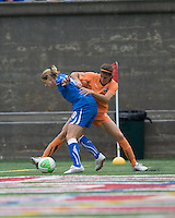Boston Breakers forward/midfielder Kelly Smith (10) and Sky Blue FC defender Brittany Taylor (14) battle in the corner. Sky Blue FC defeated the Boston Breakers, 2-1, at Harvard Stadium on June 13, 2010.
