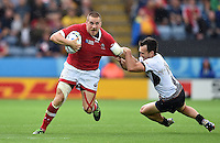 Nick Blevins of Canada looks to get past Michael Wiringi of Romania. Rugby World Cup Pool D match between Canada and Romania on October 6, 2015 at Leicester City Stadium in Leicester, England. Photo by: Patrick Khachfe / Onside Images