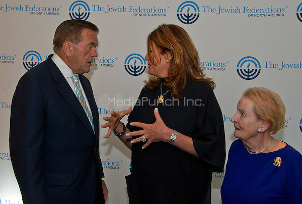 Lisa Friedman Clark, center, who's husband Andrew Friedman, was killed in the World Trade Center attack on September 11, 2001, speaks with former United States Secretary of Homeland Security Tom Ridge prior to speaking before 1300 women philanthropists at the Jewish Federations' 2016 International Lion of Judah Conference at the Washington Hilton Hotel on Sunday, September 11, 2016.  Looking on at right is former US Secretary of State Madeleine Albright.<br /> Credit: Ron Sachs / CNP /MediaPunch