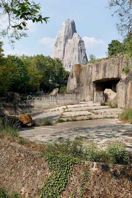 Low angle view of Asian Elephants' Plateau with the Grand Rocher (Great Rock) in the background, Parc Zoologique de Paris, or Zoo de Vincennes, (Zoological Gardens of Paris, also known as Vincennes Zoo), 1934, by Charles Letrosne, 12th arrondissement, Paris, France, pictured on April 26, 2011 in the afternoon. In November 2008 the 15 hectare Zoo, part of the Museum National d'Histoire Naturelle (National Museum of Natural History) closed its doors to the public and renovation works will start in September 2011. The Zoo is scheduled to re-open in April 2014. Picture by Manuel Cohen.