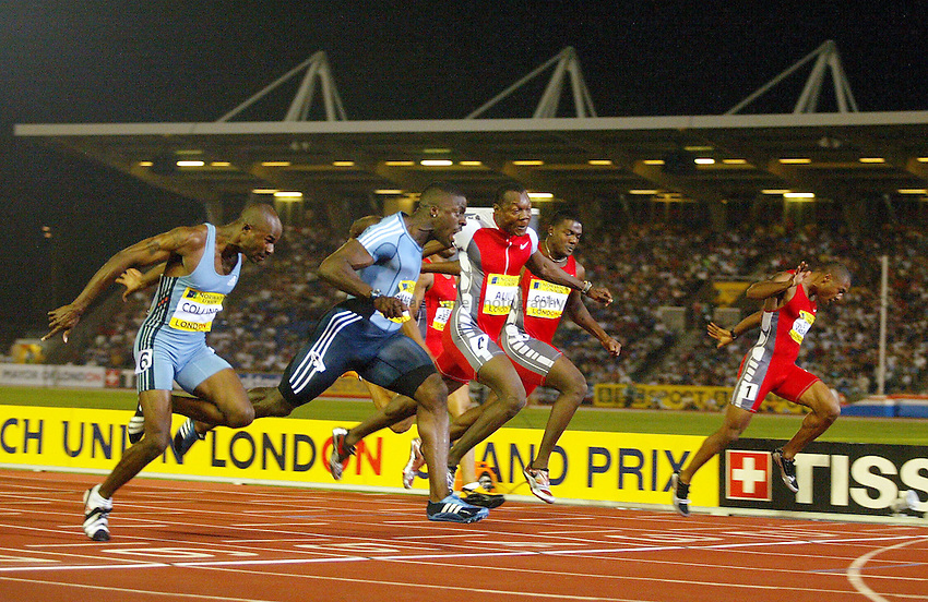 Photograph: Scott Heavey..IAAf Super Grand Prix. Norwich Union London Athletics meeting from Crystal Palace. 08/08/2003..Dwain Chambers (Second from left) stretches to win the mens 100m