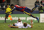 22 November 2009: Salt Lake's Robbie Findlay (above) is sent flying by a tackle by Los Angeles's Gregg Berhalter (below). The Los Angeles Galaxy played Real Salt Lake at Qwest Field in Seattle, Washington in MLS Cup 2009, Major League Soccer's championship game.
