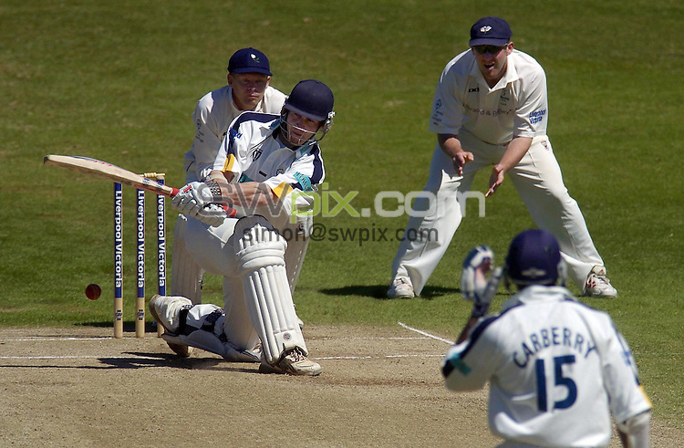PICTURE BY VAUGHN RIDLEY/SWPIX.COM -  Cricket - Liverpool Victoria County Championship, Day Four - Yorkshire v Hampshire - Headingley, Leeds, England - 03/06/06...? Simon Wilkinson - 07811 267706...Hampshire's James Adams (C), on 65 at lunch sweeps for 4 runs .  Yorkshire's Gerard Brophy (L) and Anthony McGrath (R).