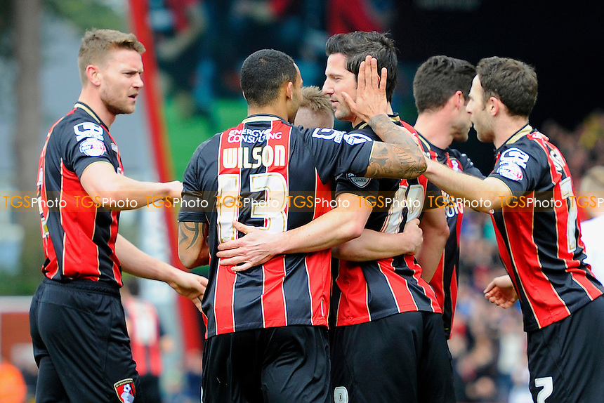Yann Kermorgant of AFC Bournemouth middle is congratulated after scoring from the penalty spot - AFC Bournemouth vs Middlesbrough - Sky Bet Championship Football at the Goldsands Stadium, Bournemouth, Dorset - 21/03/15 - MANDATORY CREDIT: Denis Murphy/TGSPHOTO - Self billing applies where appropriate - contact@tgsphoto.co.uk - NO UNPAID USE