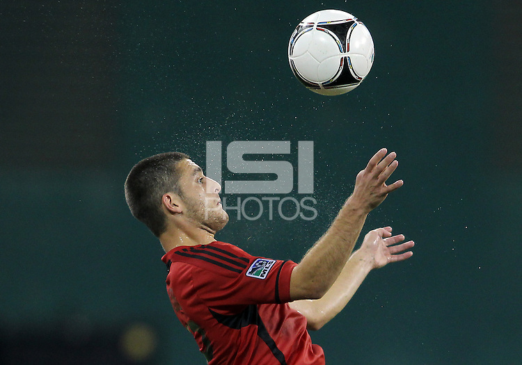WASHINGTON, DC - July 28, 2012:  Chris Kolb (22) of DC United pulls in a high cross against PSG (Paris Saint-Germain) in an international friendly match at RFK Stadium in Washington DC on July 28. The game ended in a 1-1 tie.
