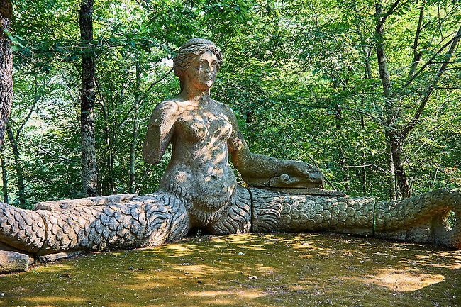 statue of Echidina, mother of the many enemies of Hercules, vainly in love with Glauco, the sea God, commissioned by Piaer Francesco Orsini c. 1513-84, The Renaissance Mannerist statues of the Park of Monsters or The Sacred Wood of Bamarzo, Italy