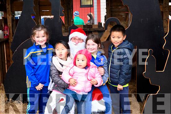 Meeting Santa in Killorglin on Saturday<br /> L-R Niamh Murphy, Chloe Jiang, Rebecca Jiang, Orla Murphy & Leo Jiang
