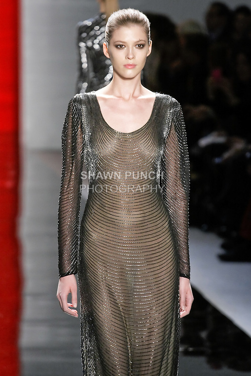 Yulia walks runway in a ebony swag-embroidered silk chiffon long-sleeved gown, from the Reem Acra Fall 2012 Feminine Power collection fashion show, during Mercedes-Benz Fashion Week New York Fall 2012 at Lincoln Center.