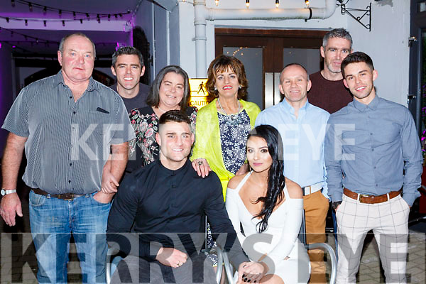 Seated front centre, Nicole Roche and Denis McElligott of Tralee celebrate their engagement with their family in Benners Hotel on Saturday night last.