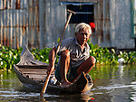 OLD MAN ON BOAT  IN CHONG KOS FLOATING VILLAGES AT TONLE SAP RIVER