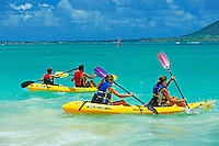 Family kayaking offshore at Kailua Beach Beach on the windward side of the island of Oahu