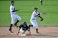 Jamestown Jammers second baseman Erik Forgione (25) attempts to turn a double play as Brett Vertigan (2) slides in and Tyler Filliben (15) backs up the play during a game against the Vermont Lake Monsters on July 13, 2014 at Russell Diethrick Park in Jamestown, New York.  Jamestown defeated Vermont 6-2.  (Mike Janes/Four Seam Images)