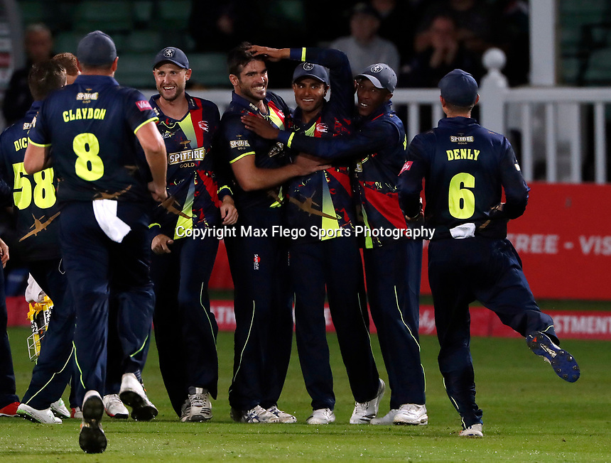 Grant Stewart of Kent is mobbed after taking the wicket of Myburgh during the Vitality Blast T20 game between Kent Spitfires and Somerset at the St Lawrence Ground, Canterbury, on Thur Aug 16, 2018