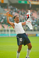 Claudio Reyna celebrates after helping defeat Mexico 2-0 in the second round of the World Cup in Jeonju, Soth Korea, Monday June 17, 2002. Images provided in partnership with International Sports Images. (Please credit: John Todd/Int'l Sports Images/DSA)