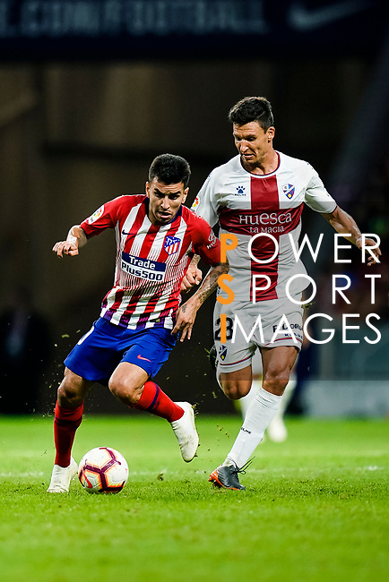 Angel Correa of Atletico de Madrid (L) in action against Marcelo Musto of SD Huesca (R) during the La Liga  2018-19 match between Atletico de Madrid and SD Huesca at Wanda Metropolitano Stadium on September 25 2018 in Madrid, Spain. Photo by Diego Souto / Power Sport Images