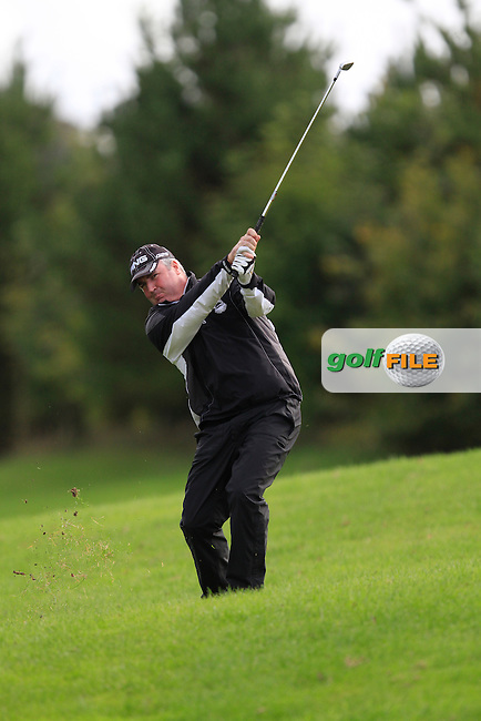 Damien Mooney (Ballyliffin G.C) on the 18th during Round 4 of The Cassidy Golf 103rd Irish PGA Championship in Roganstown Golf Club on Sunday 13th October 2013.<br /> Picture:  Thos Caffrey / www.golffile.ie