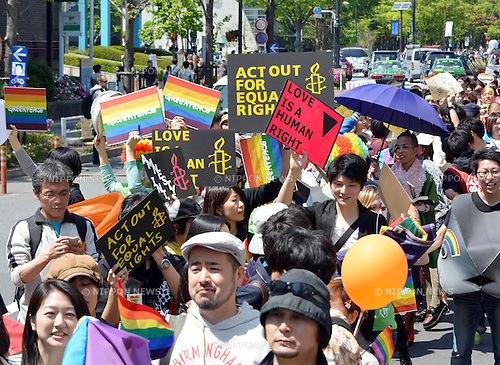 """April 28, 2013, Tokyo, Japan - Sexual minorities - gays, lesbians, bisexuals and transgenders - take to the streets of Tokyo's Shibuya district, launching the first """"Tokyo Rainbow Week,"""" a series of events aimed at supporting sexual minorities, on Sunday, April 28, 2013. Some 12,000 people in colorful costumes participated in the parade to kick off the special events which runs until May 6. (Photo by Natsuki Sakai/AFO).."""