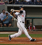 Aces Trent Oeltjen swings against the Tacoma Rainiers on Friday night.  Tom Smedes photo.
