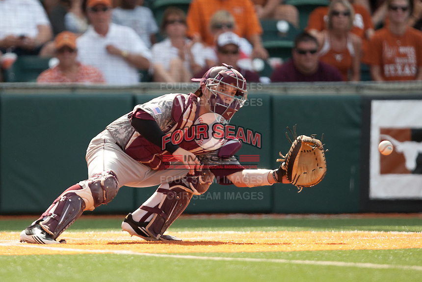 Texas A&M Aggies catcher Cole Lankford #12 receives a throw from first base just before Texas scores the winning run in the bottom of the ninth inning of the NCAA baseball game on April 29, 2012 at UFCU Disch-Falk Field in Austin, Texas. The Longhorns beat the Aggies 2-1 in the last ever regular season game scheduled for the long time rivals. (Andrew Woolley / Four Seam Images)