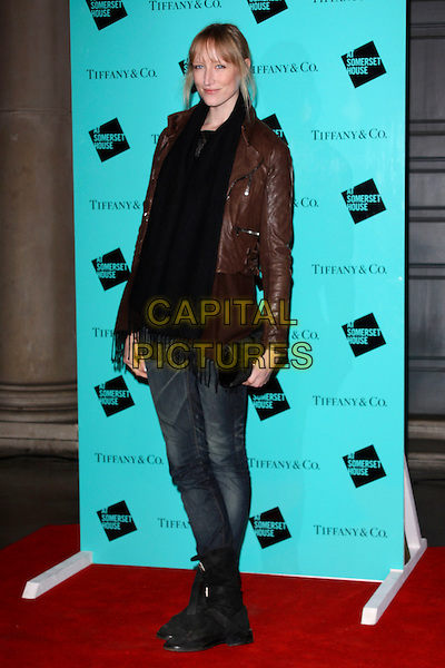 JADE PARFITT .Tiffany & Co. presents Skate at Somerset House, VIP Opening of the 10th Annual Somerset House Ice Rink, London, England..November 16th, 2009.full length jeans denim tucked into boots leather jacket brown scarf black hand.CAP/AH.©Adam Houghton/Capital Pictures.