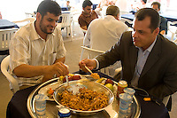 Tripoli, Libya.  Muslim Wedding Celebrations.  Wedding Lunch, Couscous, of lamb, semolina, onions, carrots.  It is common on such occasions to eat from the same bowl.