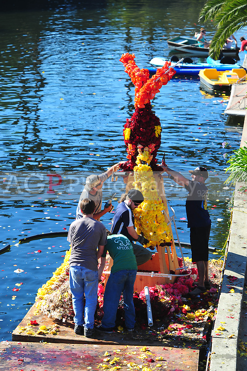 Sept. 6, 2011 - Capitola, California - U.S. - Workers dismantle a float covered with flowers on the river near Capitola Beach. Capitola, California is bursting with stun, surf, tourists and locals Monday September 5, 2011. (Credit Image: Alan Greth).