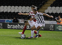 Dougie Imrie pressured by Stephen Hendrie in the St Mirren v Hamilton Academical Scottish Communities League Cup match played at St Mirren Park, Paisley on 25.9.12.