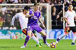 Toni Kroos (r) of Real Madrid battles for the ball with Enzo Nicolas Perez of Valencia CF during their La Liga match between Valencia CF and Real Madrid at the Estadio de Mestalla on 22 February 2017 in Valencia, Spain. Photo by Maria Jose Segovia Carmona / Power Sport Images