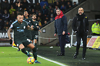 Swansea City manager Paul Clement and Manchester City manager Pep Guardiola watch on as Danilo of Manchester City uses the ball during the Premier League match between Swansea City and Manchester City at the Liberty Stadium, Swansea, Wales, UK. Wednesday 13 December 2017