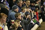 Birmingham City 0 Liverpool 7, 21/03/2006. St Andrews, FA Cup 6th Round. Birmingham City (blue) versus Liverpool,  The home side lost 0-7. Picture shows young City fans taking photos with their mobile phones. Photo by Colin McPherson.