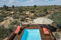 Africa, Botswana, Khwai, The Lodge, Feline Fields, edge of the Kalahari desert. Pool in the room.