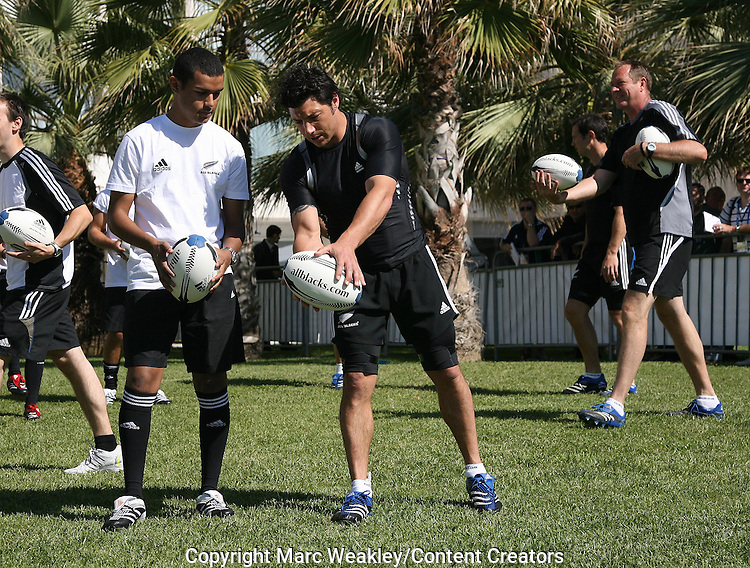 Byron Kelleher works with a local boy on his kicking. All Blacks with Zinedine Zidane, Marseille, 06 September 2007.
