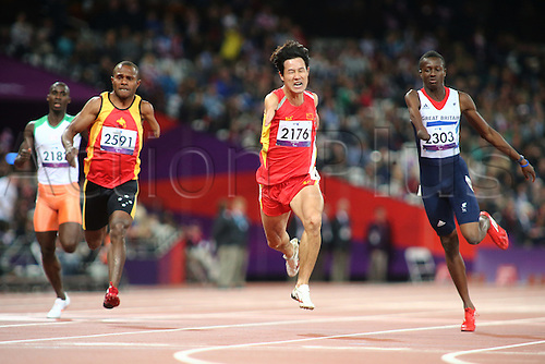 31.08.2012 London, England. Xu Zhao (CHI) comes in second in the Men's 200m - T46 with Ola Abidogun (GBR) right in 7th during Day 2 of the London Paralympics from the Olympic Stadium.