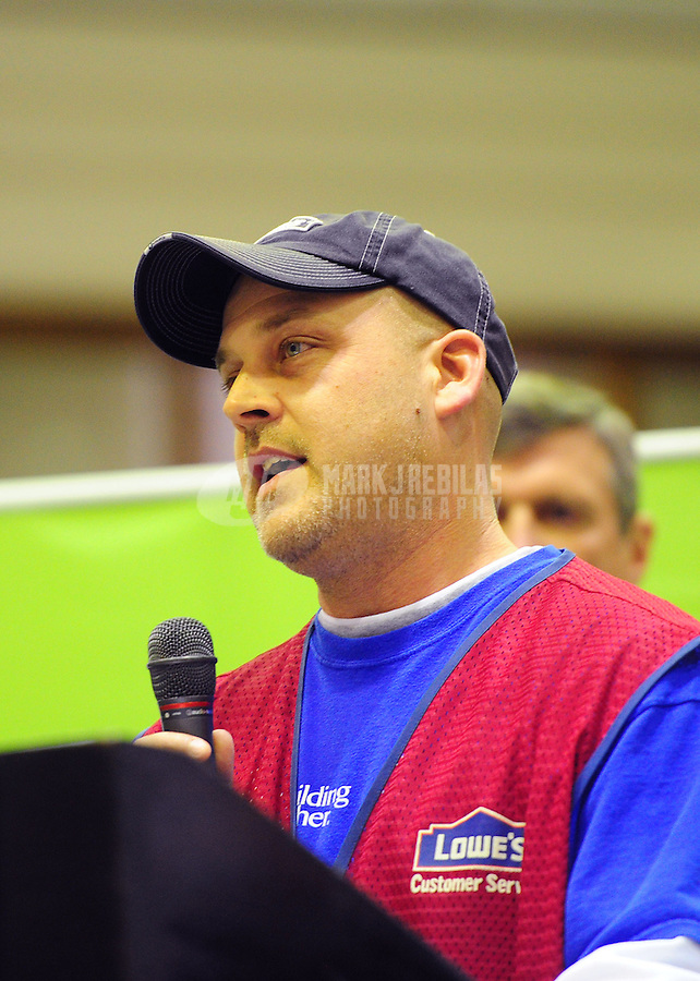 "Feb 3, 2012; Indianapolis, IN, USA; Gabe Ridgeway, store manager of a local Lowes store, speaks during the Rebuilding Together ""Kickoff To Rebuild"" press conference at Aresenal Tech High School. It is one of many events leading up to Super Bowl XLVI between the New York Giants and the New England Patriots. Mandatory Credit: Mark J. Rebilas-"
