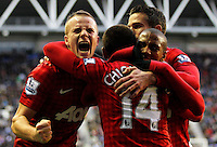Tom Cleverley (L) of Manchester United celebrates the goal of team mate Javier Hernandez (C) - Barclays Premier League - Wigan Athletic v Manchester United - DW Stadium - Wigan - England - 1st January 2013 .Football Calcio 2012/2013.Premier League.Foto Insidefoto .ITALY ONLY