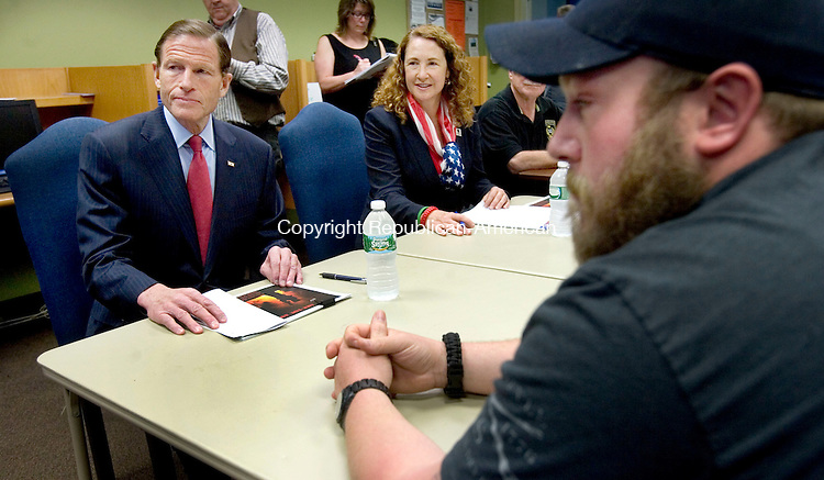 WATERBURY CT. 08 May 2015-050815SV06-Rep. Elizabeth H. Esty, D-5th District and Sen. Richard Blumenthal, D-Conn listen to veterans during a roundtable discussion on toxic burn pits in the Veterans Oasis room of the Student Center at Naugatuck Valley Community College in Waterbury Friday. <br /> Steven Valenti Republican-American