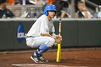 UCLA outfielder Brian Carroll (24) on deck against the North Carolina State Wolfpack during Game 8 of the 2013 Men's College World Series on June 18, 2013 at TD Ameritrade Park in Omaha, Nebraska. The Bruins defeated the Wolfpack 2-1, eliminating North Carolina State from the tournament. (Andrew Woolley/Four Seam Images)