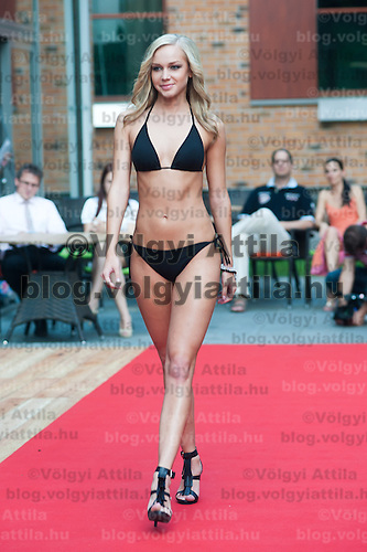 Nikolett Nemeth a participant of the Beauty Queen contest attends a bikini tour in Hotel Abacus, Herceghalom, Hungary on July 07, 2011. ATTILA VOLGYI